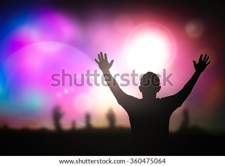 Silhouette people raising hands on blurred colorful light background. Worship, Forgiveness, Mercy, Humble, Evangelical, Hallelujah, Thankful, Praise, Redeemer, Amen, Human Rights Day, Humanity concept - stock photo