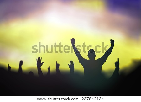 Silhouette people raising hands over blurred stadium. Merry Christmas Card, Thankful, Repentance, Reconcile, Adoration, Glorify, Peace, Evangelical, Hallelujah concept - stock photo
