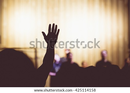 Silhouette people raising hands over .God concept. - stock photo