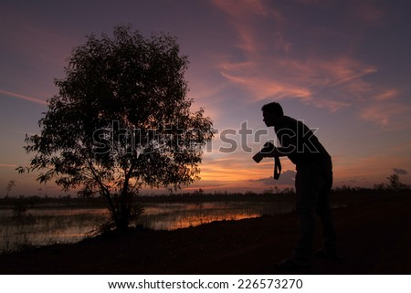 Silhouette photo of photographers - stock photo