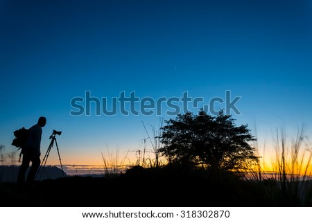 silhouette photographer on amazing color during sunrise