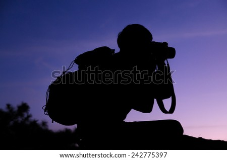silhouette photographer take a photo on colorful background
