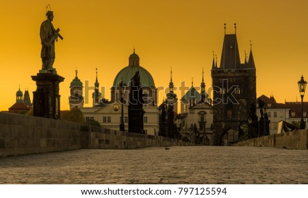 Silhouette photography of Charles Bridge during yellow morning time, Prague,,Czech Republic