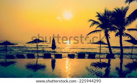 Silhouette pool beach and palm tree sunset times process vintage instagram effect style picture - stock photo