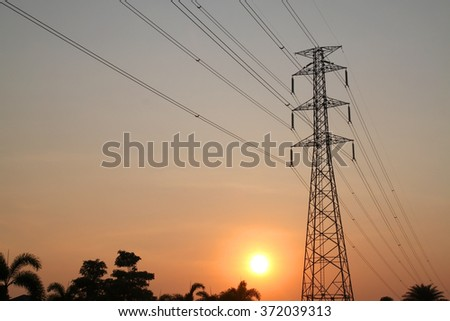 Silhouette power pole with sunset on sky background