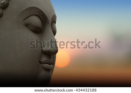 Silhouette public Buddha statue, over sunset in Thailand background. - stock photo