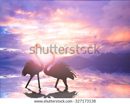 Silhouette romantic Flamingo during valentine's day over sunset - stock photo