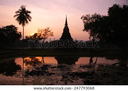 Silhouette ruins temple of Sukhothai historical park - stock photo