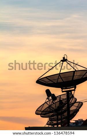 silhouette Satellite dish on twilight time - stock photo