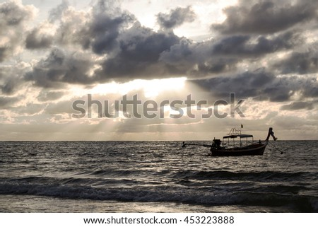 Silhouette seascape sunset of fishing boat