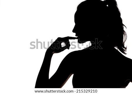 silhouette - sensual portrait of a woman touching her lips
