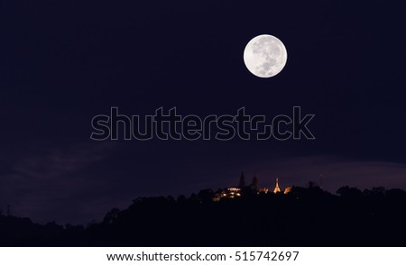 silhouette shot image of big moon at Wat Phra That Doi Suthep temple ,Chiang mai,Thiland.