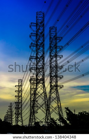 silhouette shot of Electricity pylons - stock photo