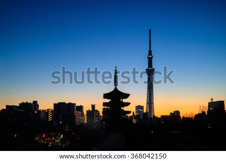 Silhouette shot of Tokyo skyline with Senso-ji Temple and Tokyo skytree at twilight in Japan. - stock photo