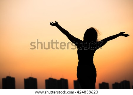 silhouette success woman hands up