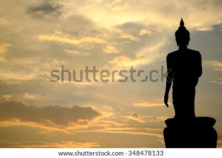 Silhouette Sunset of big buddha (walking buddha), Thailand