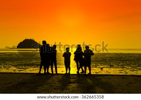 Silhouette, Sunset on the beach with friends