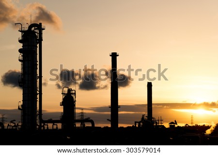 Silhouette sunset scene at Oil & Gas Refinery - stock photo