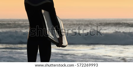 Silhouette surfer bodyboard man on beach at sunset,male body surfer