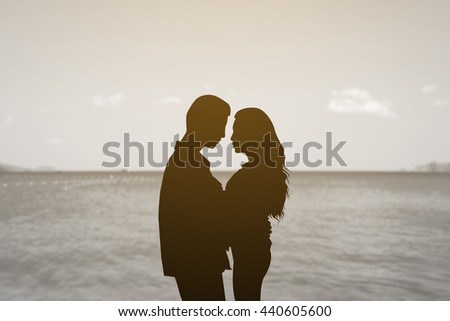 silhouette teenager lovers couple over sea beachnatural background:black shadow loving people hug and kiss:love and valentines concept:matrimonial amour affection wedding anniversary:vintage effect. - stock photo
