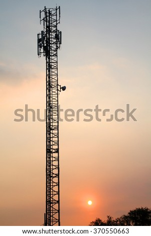 silhouette Telecommunication tower with sunset on sky background