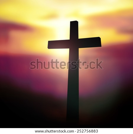 Silhouette the cross on blurred sunset background.