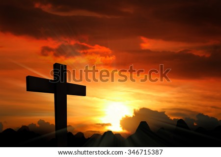Silhouette the cross over blurred sunset background.
