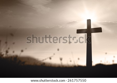 Silhouette the cross over blurred sunset background. Thanksgiving, Christmas, Worship, Forgiveness, Mercy, Humble, Repentance, Reconcile, Adoration, Glorify concept. - stock photo