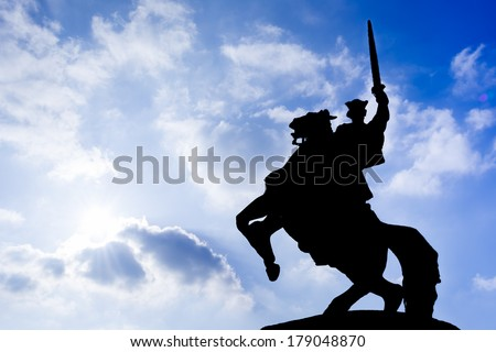 silhouette - The 7.8 metres tall Bronze statue of King Svatopluk, the greatest king of the Great Moravian Empire, astride his horse in front of Bratislava Castle. The statue was designed by Jan Kulich - stock photo