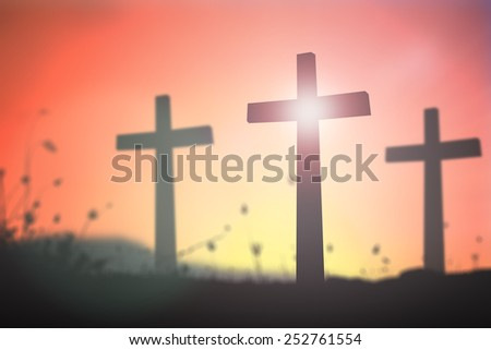 Silhouette three crosses  over blurred sunset background. - stock photo