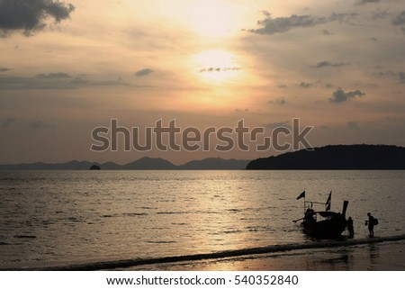 Silhouette traditional thai long tail boats on the sea, Sunset