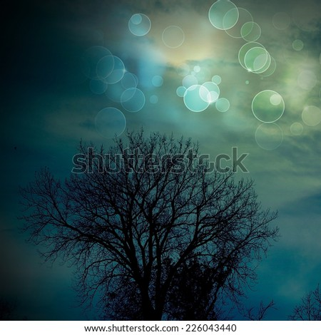 Silhouette tree with dark clouds before a thunder-storm  - stock photo