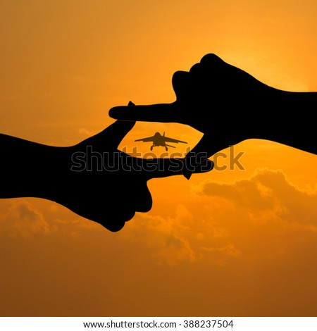 silhouette two hands look for a shooting take a photography parachute. - stock photo