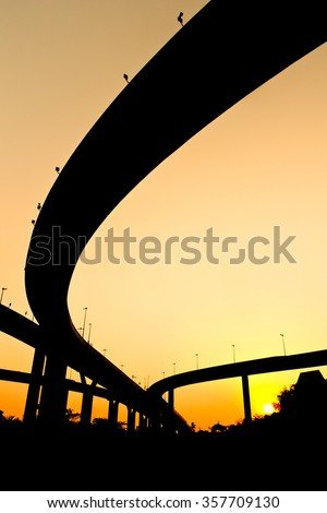 Silhouette view of expressway routes under twilight sky - stock photo