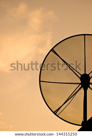 Silhouette view of half satellite dish under twilight sky