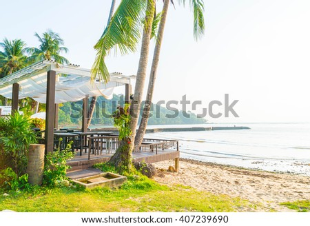 silhouette view with bower on the beach at sunset time - boost up color processing - stock photo