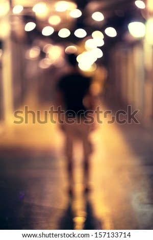 Silhouette, walking through the tunnel. - stock photo