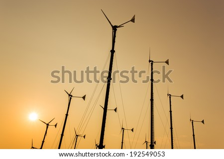 Silhouette windmills for electric power production at  Koh Larn ,Pattaya,Thailand