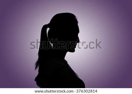 Silhouette woman portrait, concept of unknown, anonymous, unnamed etc. - stock photo