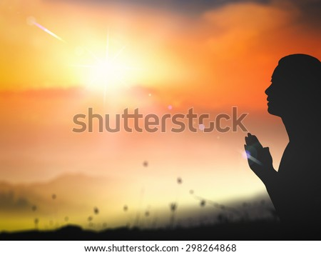 Silhouette woman pray on beautiful golden autumn sunset with amazing light background. Worship, Christmas, Thanksgiving, Forgiveness, Mercy, Humble, Repentance, Reconcile, Adoration, Glorify concept. - stock photo