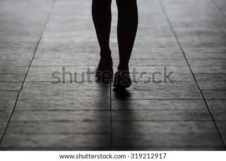 Woman walking away from man silhouette