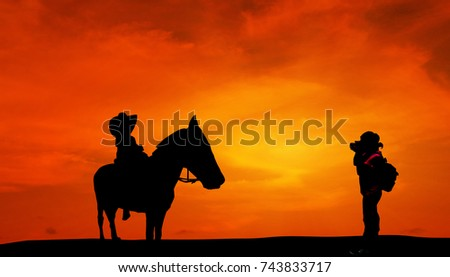 Silhouette Women photograph Boy ride horse In the evening sun Shine.