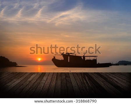 Silhouette Wooden paving and  ship in sunset sunrise
