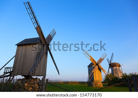 Silhouette wooden windmill in Angla, Saaremaa Island, Estonia - stock photo