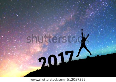 Silhouette young man Happy for 2017 new year background  blurred of  the Milky Way galaxy on a bright star dark sky tone