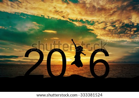 Silhouette young woman jumping on the sea and 2016 years while celebrating new year - stock photo