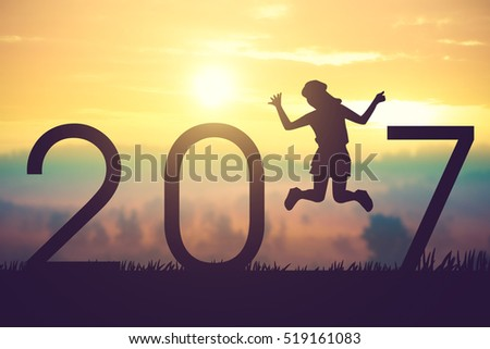 Silhouette young woman jumping on the sunset and 2017 years while celebrating new year.Vintage color