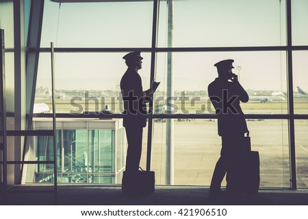 silhouetted airline member crew  - stock photo