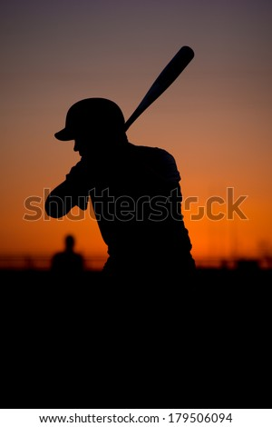 Silhouetted Baseball Batter at Sunset