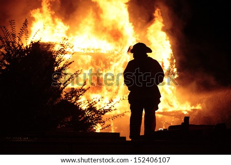 Silhouetted Firefighter